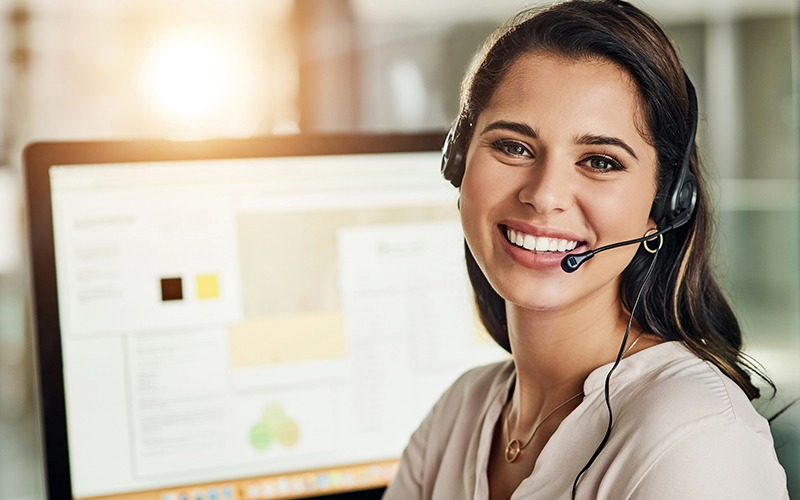 Smiling young lady on the phone for customer service