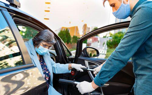 Nurse helping elderly lady out of car