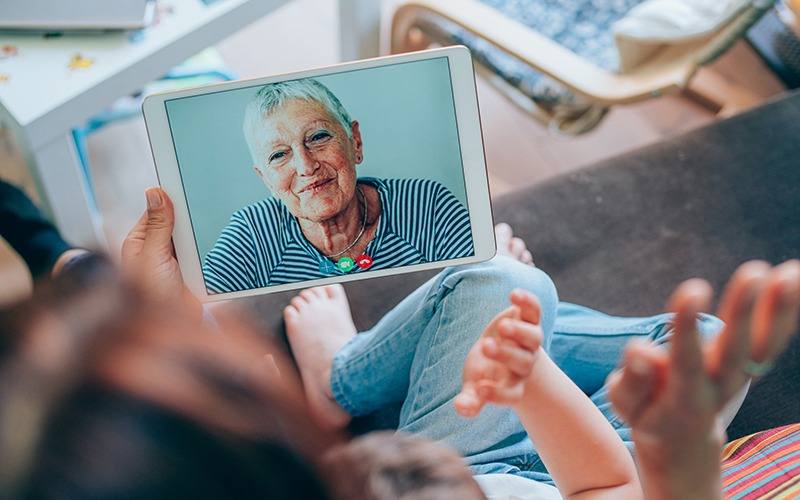 Kids video calling with grandmother on Ipad